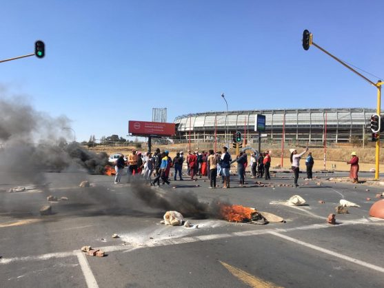 Protesters block roads with rocks and burning tyres in Mzimhlophe, Soweto, 17 July 2019. Picture: Bhekikhaya Mabaso / African News Agency (ANA)