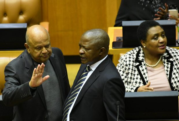 Public Enterprises Minister Pravin Gordhan chatting to deputy president David Mabuza ahead of President Cyril Ramaphosa replying to the debate on the presidency budget vote, 18 July 2019. Photo: Supplied by GCIS
