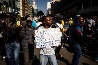 Zimbabwe police beat protesters defying ban