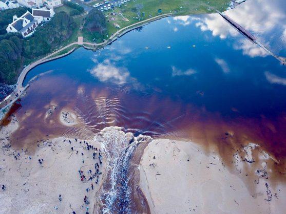 Western Cape rain causes Kleinmond lagoon to burst into ocean after four years