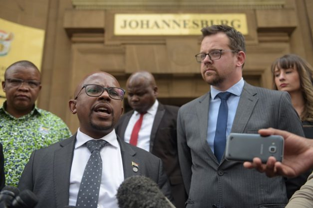 Nelson Mandela Foundation chief executive Sello Hatang  together with Ernst Roets, AfriForum Head of Policy and Action, speaks to the media after Judge President Phineas Mojapelo delivered judgment in the Nelson Mandela Foundation's so-called 'apartheid flag' case in the Equality Court sitting in the High Court in Johannesburg. 21 August 2019. Picture: Tracy Lee Stark