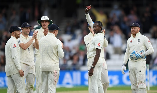England bowler Jofra Archer celebrates by raising the ball after dismissing  Pat Cummins to claim his first 5 wicket haul during day one of the 3rd Ashes Test match between England and Australia at Headingley on August 22, 2019 in Leeds, England. (Photo by Stu Forster/Getty Images)