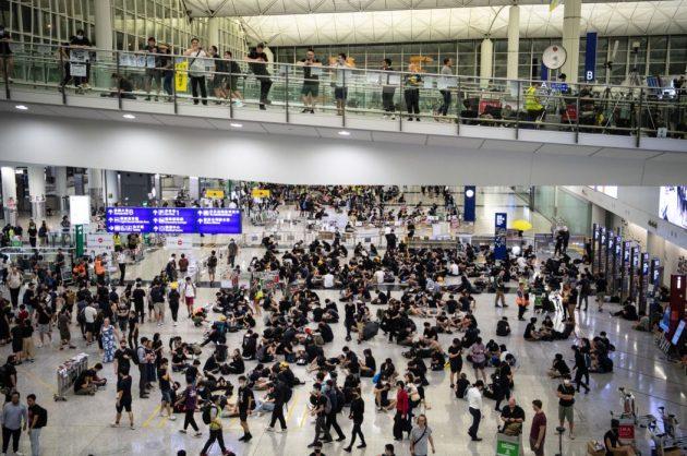Protesters block departing passengers at Hong Kong airport