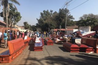 Residents find used coffins during drug 'raid'