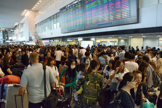 Passengers wait at the arrivals hall of Narita International Airport for transportation as trains running to and from the airport were halted due to passing Typhoon Faxai in Narita, Chiba Prefecture on September 9, 2019. The powerful typhoon that battered Tokyo overnight with ferocious winds killed two people, police said on September 9, as halted trains caused commuter chaos and more than 100 flights were cancelled.  / AFP / JIJI PRESS / jiji press