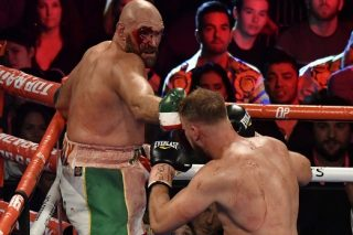 Bloodied but unbowed, Fury 'ready for war' against Wilder