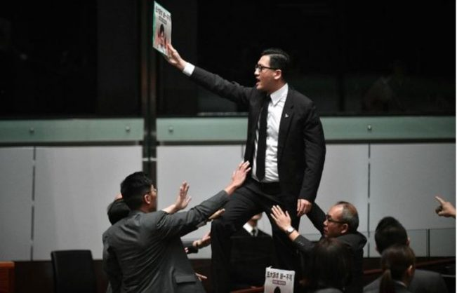 Hong Kong chief abandons policy speech; protest leader hospitalised