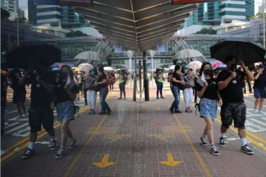 Hong Kong defies China anniversary with 'Day of Grief' rallies and clashes