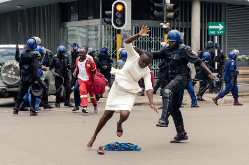 Zim police beat opposition supporters after rally ban