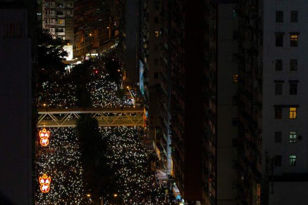 Hong Kongers await Beijing olive branch after rare calm