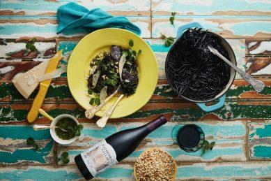 Recipe: Squid ink pasta with pesto verde, black salami & parmesan