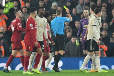 United charged by FA over players' misconduct in Liverpool defeat