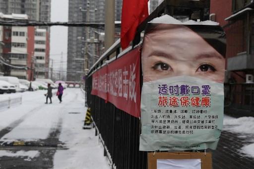 Beijing orders returnees to quarantine as virus death toll hits 1,523