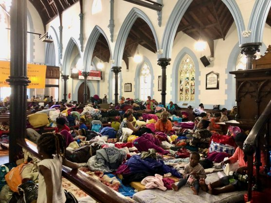 Cops start removing refugee informal structures outside Methodist church in Cape Town