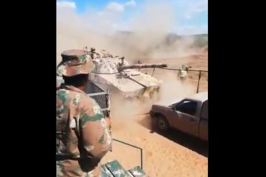 WATCH: SANDF defends video of armoured vehicle crashing into fence