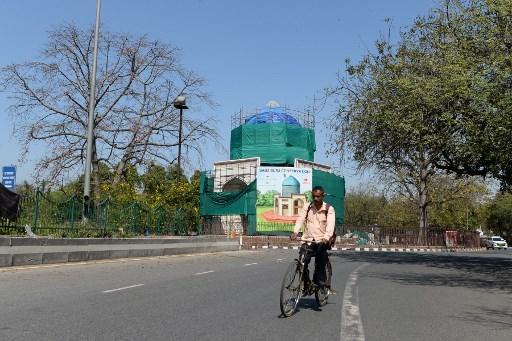 Latest virus updates in Asia: Olympics postponed, India under lockdown