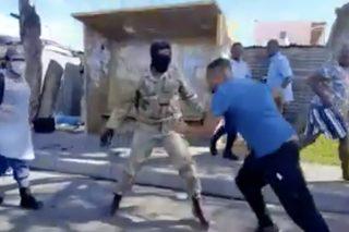 WATCH: Army members break beer bottle, slap and kick member of the public