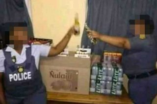 SAPS to investigate picture of officers posing with alcohol - The Citizen