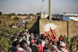 PICS: Queues for kilometres as 11,000 food parcels distributed in Pretoria - The Citizen