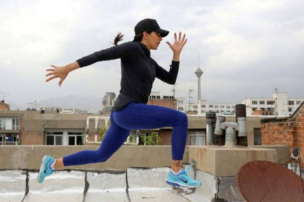 Athletics star takes to rooftop to train in virus-hit Iran