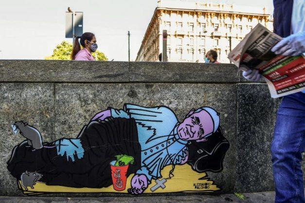 'Pope Francis' begs in Milan street, his cassock in tatters