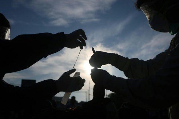 Virus deaths top 250,000 as billions pledged for vaccine push