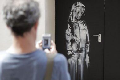 Stolen Banksy work from door of Paris Bataclan found in Italy