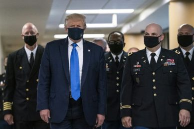 Top US health official wants 'everything done' to contain virus as Trump finally dons mask