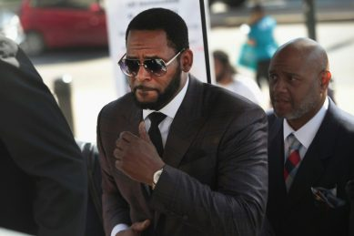 R. Kelly associates charged with intimidating singer's accusers