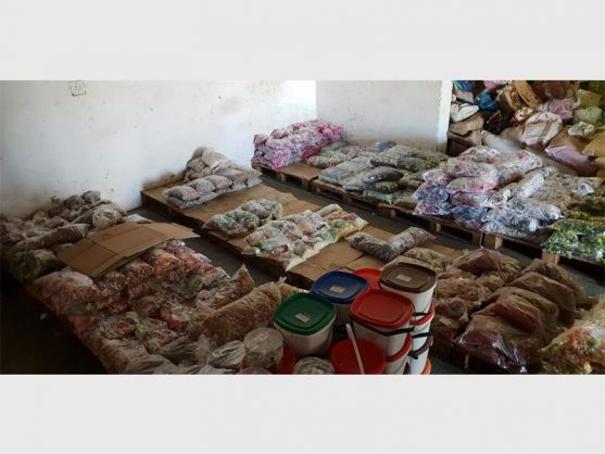 PICS: 19 arrested as cops seize expired food dating from 2010 at warehouse