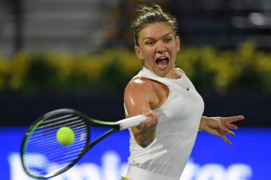 Halep grinds out win on return to court in Prague