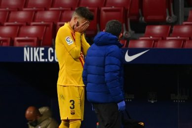 Injured Pique leaves pitch in tears against Atletico