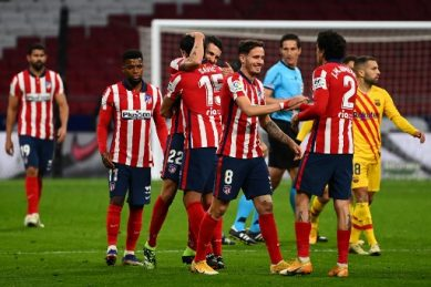 Atletico edge past Barca to earn title boost as Real Madrid held