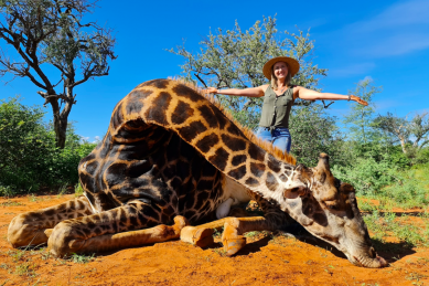 SA woman kills giraffe, poses with its heart in gruesome photo