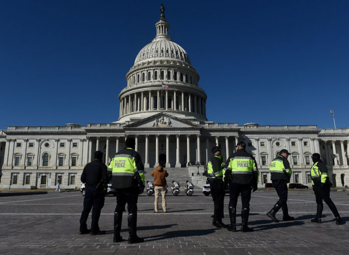 US Capitol police officers patrol the US Capitol grounds in Washington, DC , March 5, 2021. - Armed US National Guard troops patrolled the US Capitol on March 4 after officials warned of a new attack plot by extremists, but the feared show of force by those still angry over Donald Trump's election defeat did not materialize. But security officials also said that the threat is ongoing and could continue through 2022. (Photo by OLIVIER DOULIERY / AFP)