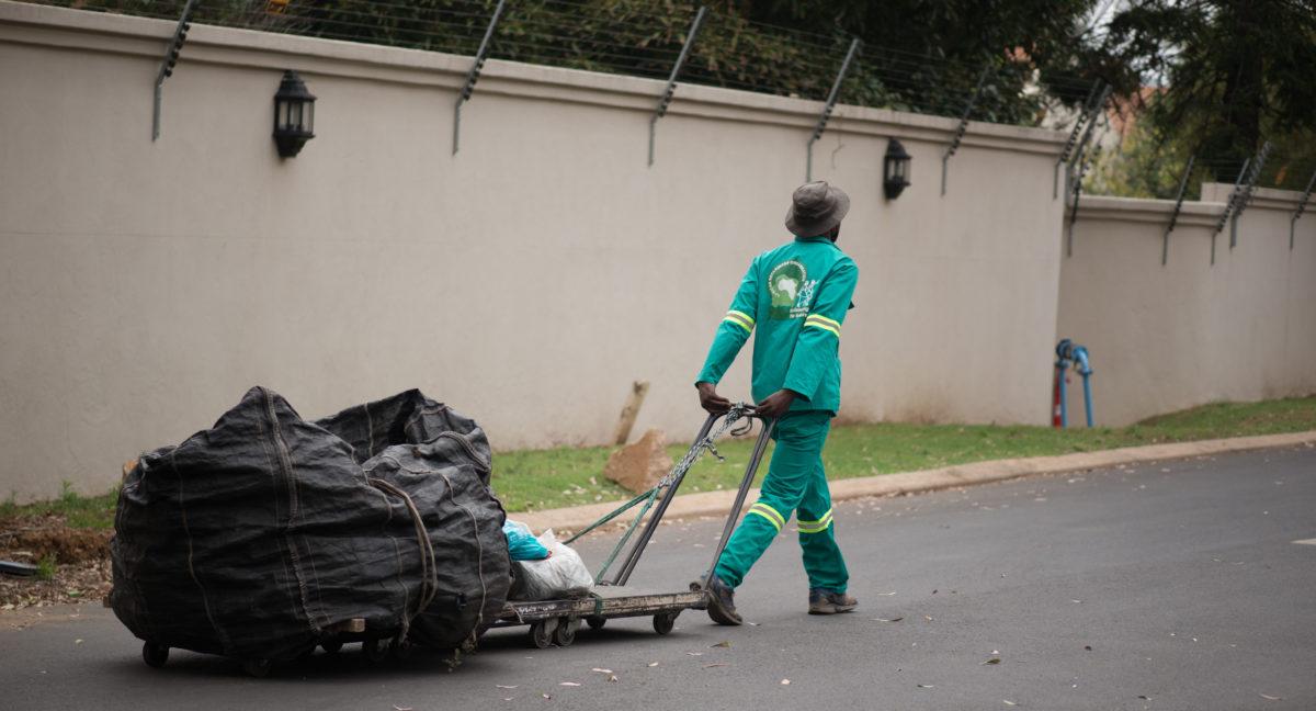 Waste reclaimer in suburbia generic image