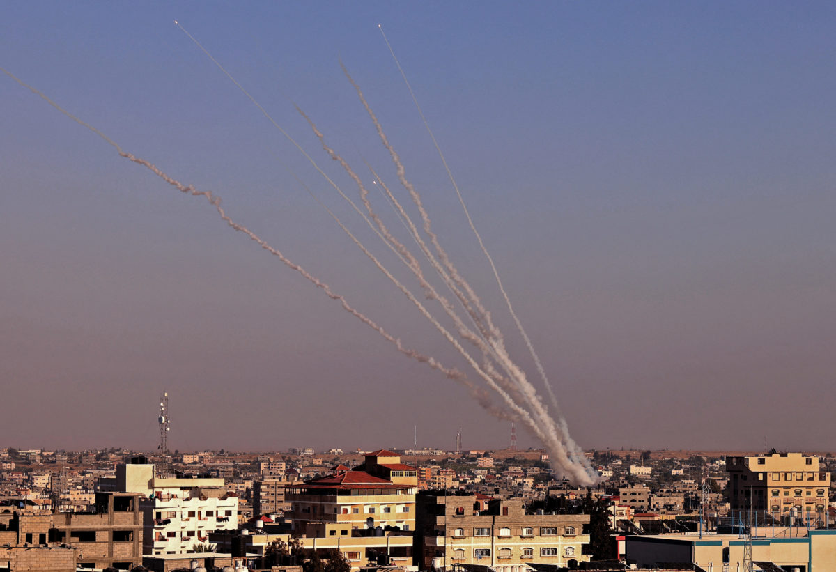 Rockets are launched towards Israel from Rafah, in the southern the Gaza Strip, controlled by the Palestinian Hamas movement, on 12 May 2021. Heavy exchanges of rocket fire and air strikes, and rioting in mixed Jewish-Arab towns, fuelled fears today that deadly violence between Israel and Palestinians could spiral into 'full-scale war'. Picture: Said Khatib/AFP