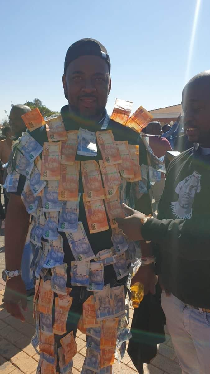 Traditional healer Michael Dlamini outside court celebrating the release Ngizwe Mchunu.