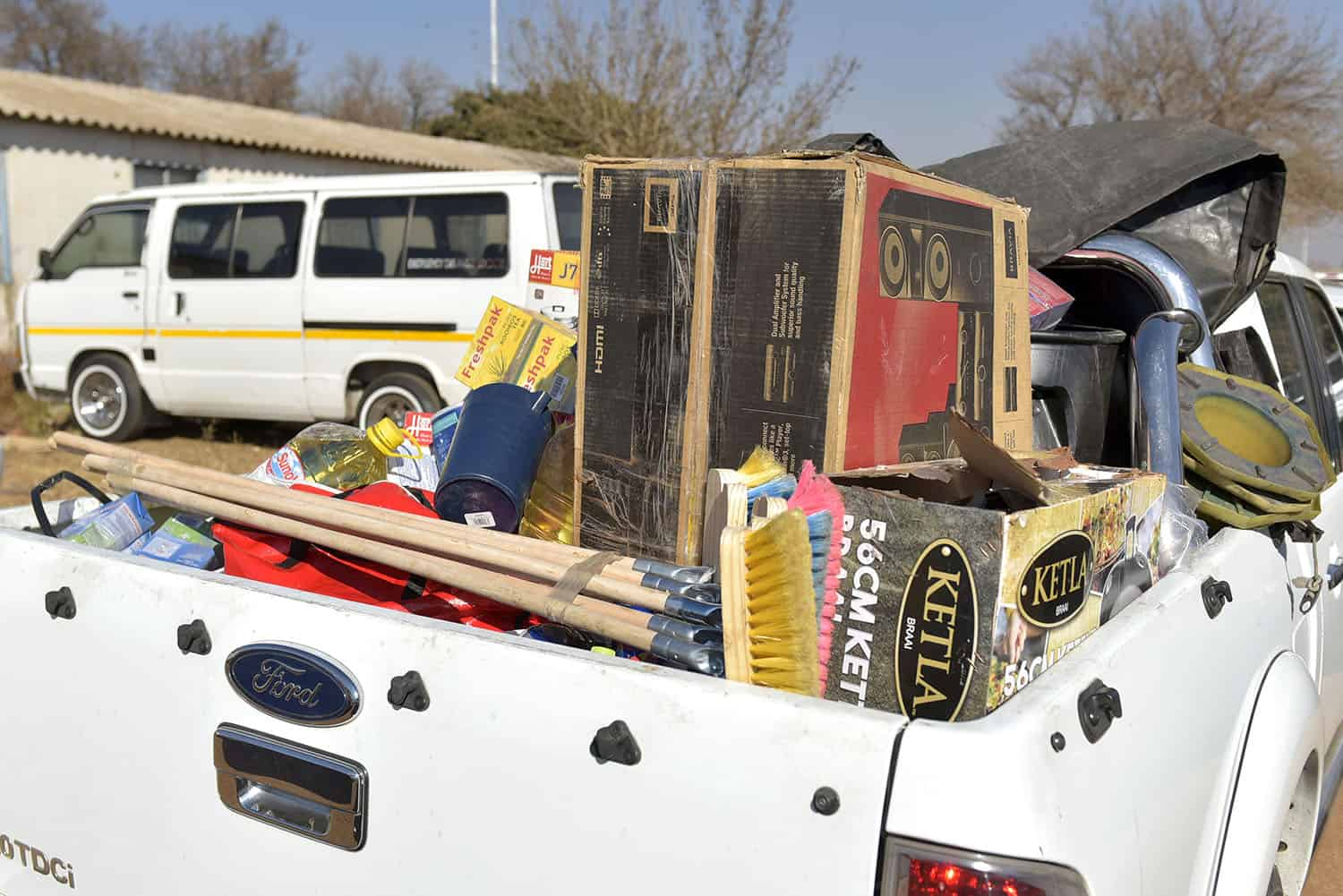Some of the confiscated items during an operation to recover looted items at the Nguni hostel in Vosloorus, 27 July 2021. Picture: Neil McCartney