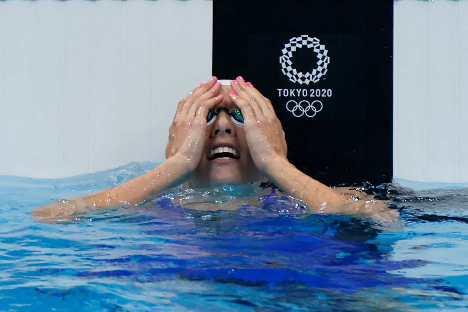South Africa's Tatjana Schoenmaker reacts after breaking an Olympic Record in a heat for the women's 100m breaststroke swimming event during the Tokyo 2020 Olympic Games at the Tokyo Aquatics Centre in Tokyo on July 25, 2021. (Photo by Odd ANDERSEN / AFP)